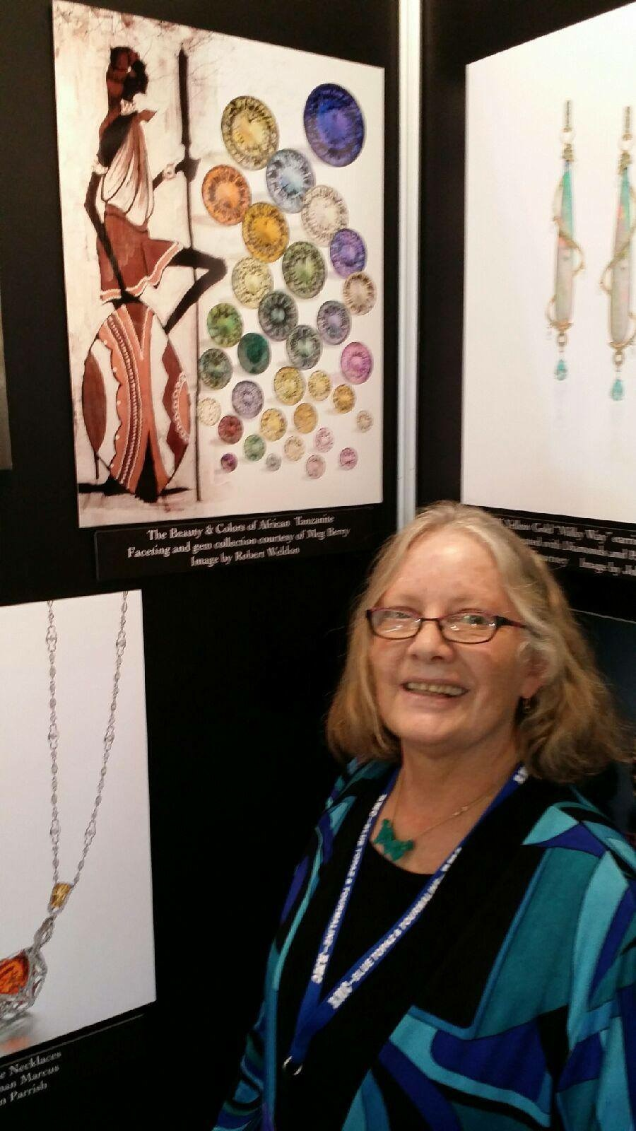 Meg Berry with poster of her cut tanzanites. Photo by Robert Weldon
